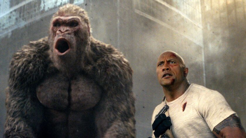 """This image released by Warner Bros. shows Dwayne Johnson in a scene from """"Rampage."""" (Warner Bros. vi"""