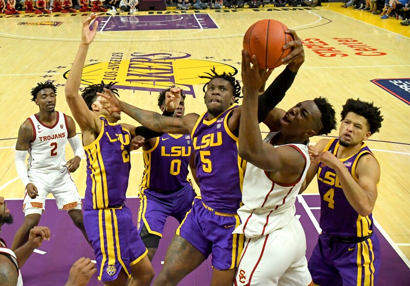 USC's Onyeka Okongwu battles Louisiana State's Emmitt Williams for a rebound Dec. 21 at Staples Center.