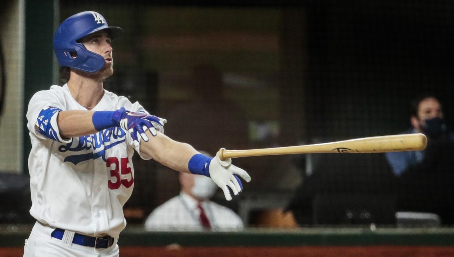Dodgers' star Cody Bellinger tossing his bat.