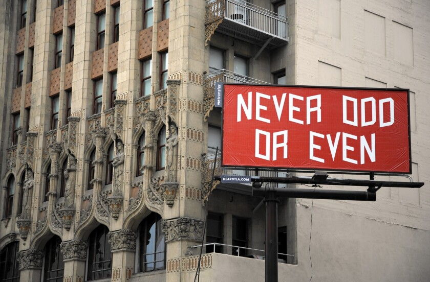 This billboard adjacent to the Ace Hotel in downtown Los Angeles now has a piece of art by Brian Roettinger. Other artists' works will follow.