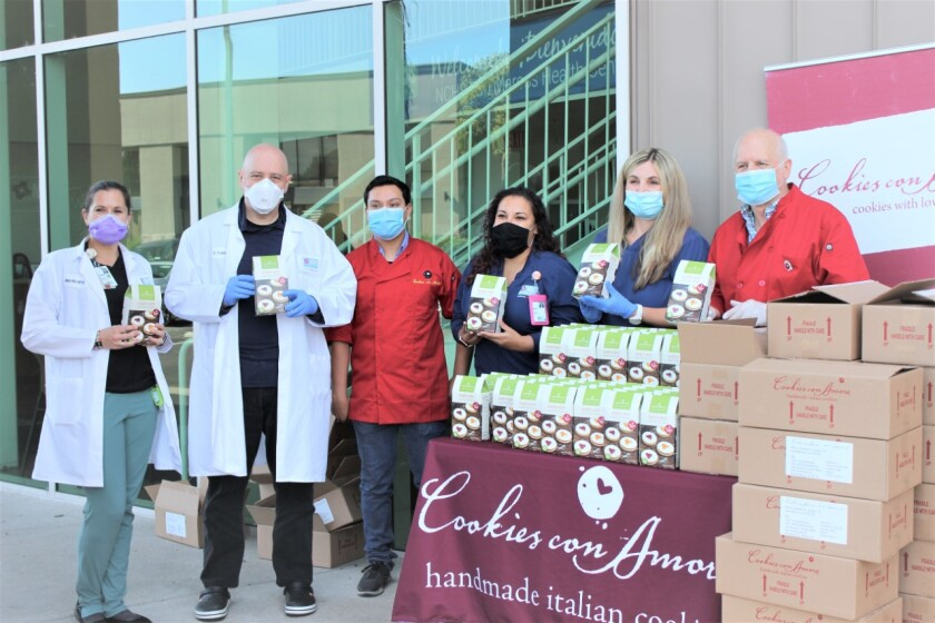 As a thank you to the COVID-19 North County Healthcare Services, Cookies Con Amore brought 300 boxes of cookies