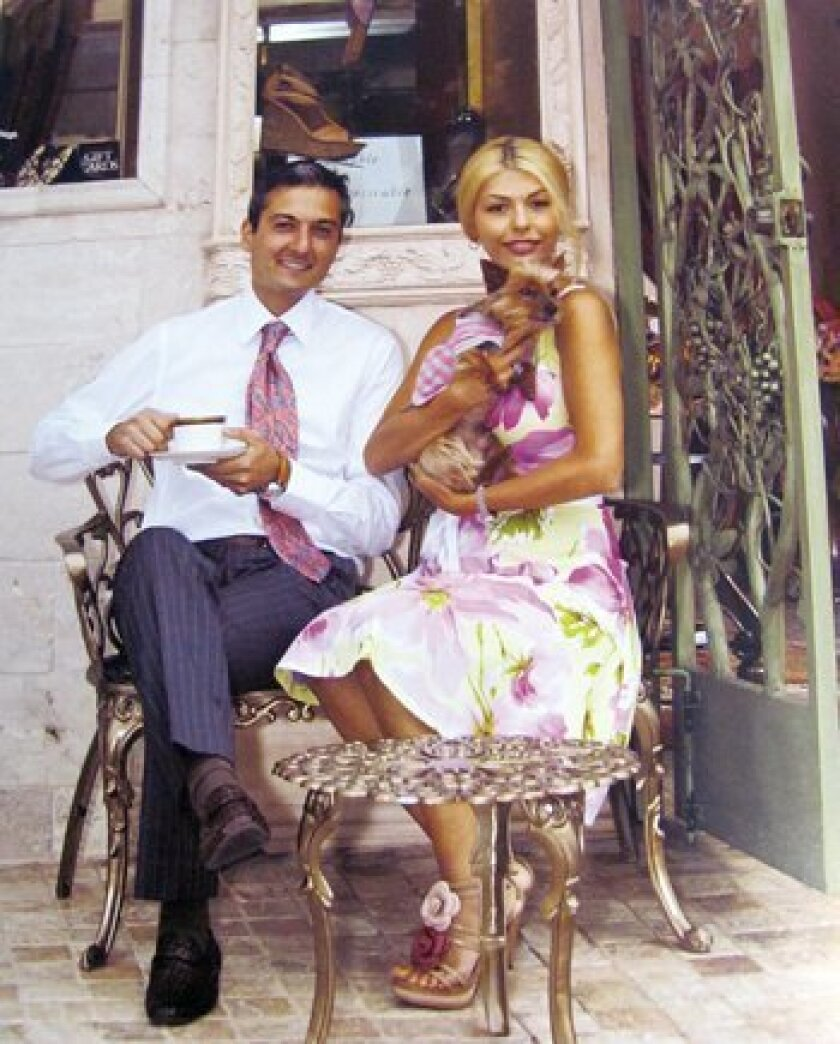 """This image of Axel and Farnaz with their dog Maja at the Serenity Show Boutique in La Jolla is from a page of """"La Jolla / 92037."""" The book is full of delightful facts, figures and foibles about The Jewel by the Sea and its residents. Photo: Paul Burlingame"""