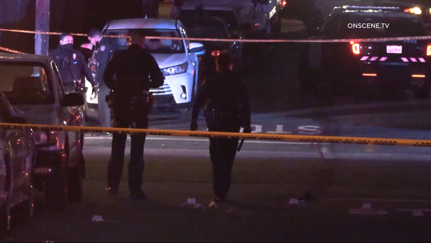 San Diego police officers investigate a fatal shooting in Mount Hope on June 20.