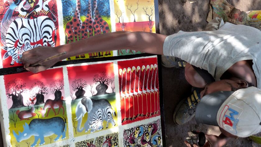 An unidentified artist at the Ujamaa artists cooperative in Mto wa Mbu.