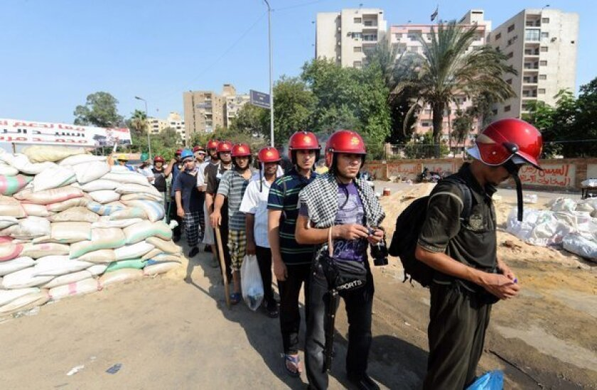 Egypt military says protesters use children as human shields