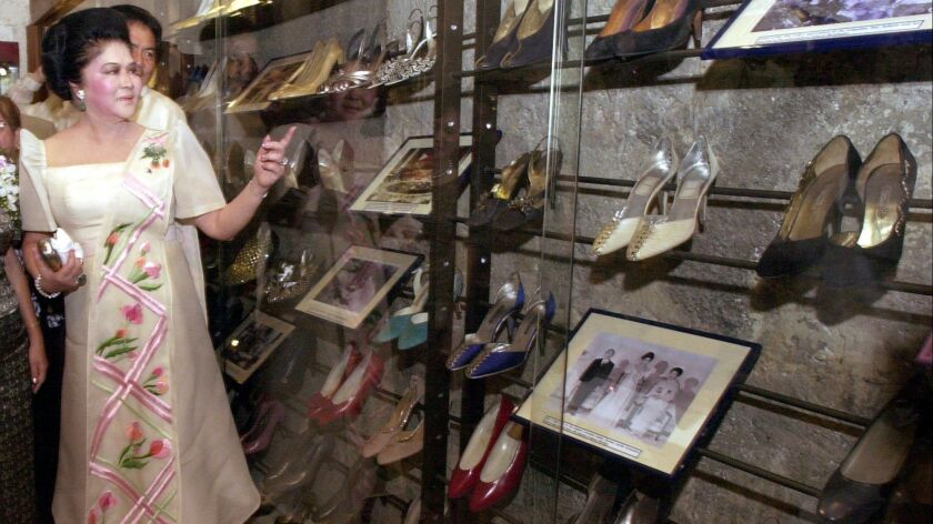 In 2001, former Philippines first lady Imelda Marcos reviewed some of her shoes on display at the Marikina Shoe Museum in the Philippines.