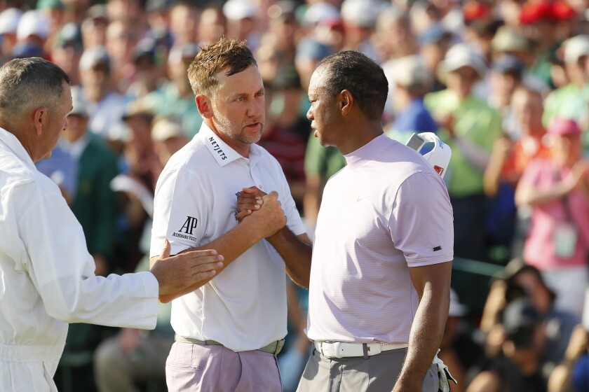 Beating some opponents matters more than others for Tiger Woods. The cheeky Ian Poulter, left, was one of those opponents on Saturday at the 2019 Masters.