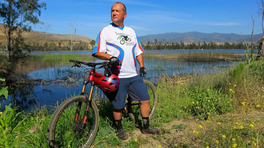 Jose Galaz, posing with his bike at Otay Lakes, took up cycling to get in shape.,