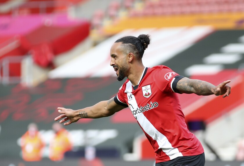 Southampton's Theo Walcott celebrates after scoring his side's third goal during the English Premier League soccer match between Southampton and Fulham at St. Mary's Stadium in Southampton, England, Saturday, May 15, 2021. (Peter Cziborra/Pool via AP)