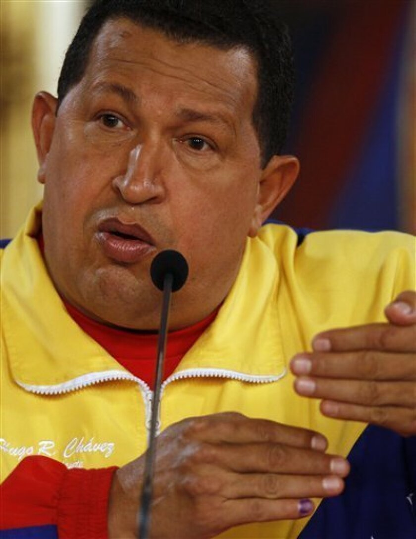 Venezuela's President Hugo Chavez gestures during a news conference with foreign media at Miraflores presidential palace in Caracas, Venezuela, Monday Sept. 27, 2010. Chavez lost the two-thirds majority in the National Assembly as his opponents made gains in congressional elections Sunday. (AP Photo/Fernando Llano)
