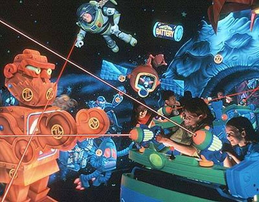 NEW INTERACTION: In 1998, kids at Disney World shoot lasers in a Buzz Lightyear ride. In June, fans at home will be able to participate in a new ride alongside park visitors.