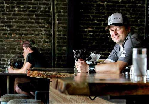 Ryan Ballinger, co-owner with Gabriel Byer of the York in Highland Park, has a seat at the bar, an L-shaped hunk of polished South American hardwood. The gastropub lists its food and drink menu on blackboards on the exposed-brick side walls.