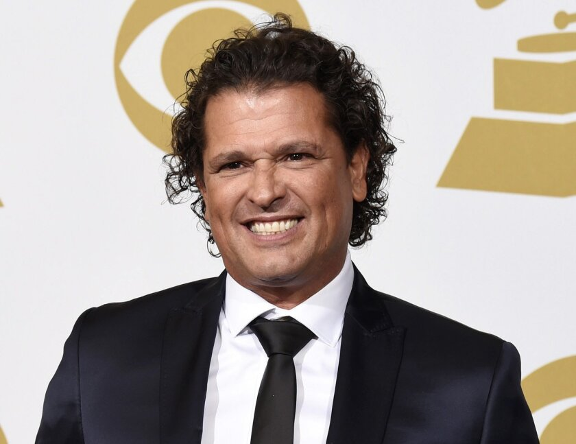"""FILE - In this Feb. 8, 2015 file photo, Carlos Vives poses in the press room at the 57th annual Grammy Awards in Los Angeles. Vives' song, """"La bicicleta,"""" a collaboration with Shakira, will be released on Friday, May 27. (Photo by Chris Pizzello/Invision/AP, File)"""