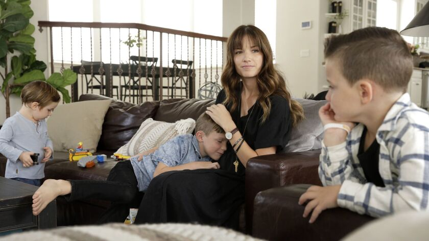 Kayla Stoecklein with her three sons Brave, from left, Smith and Jethro at their home in Corona, Calif. She writes a blog about her grief.