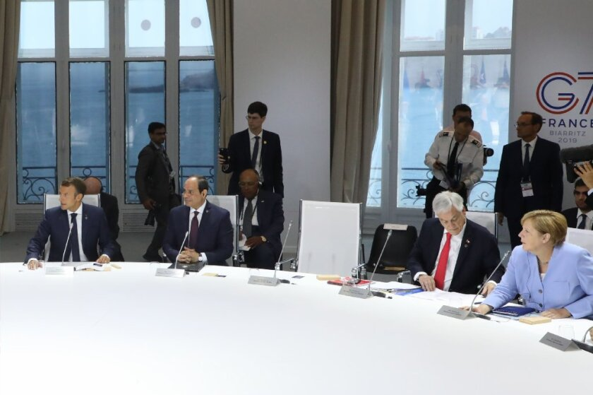 The empty chair of Donald Trump is seen as (from L) French President Emmanuel Macron, Egyptian President Abdel Fattah al-Sissi, Chile president Sebastian Piniera and German chancellor Angela Merkel attend a work session focused on climate in Biarritz, south-west France on August 26, 2019, on the third and last day of the annual G7 Summit.