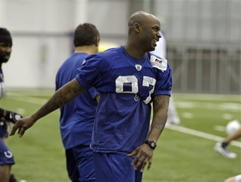Indianapolis Colts wide receiver Reggie Wayne stretches before team practice in Indianapolis, Sunday, Jan. 31, 2010. The Colts are to play the New Orleans Saints in the Super Bowl XLIV NFL football game on, Sunday, Feb. 7, in Miami. (AP Photo/Michael Conroy)