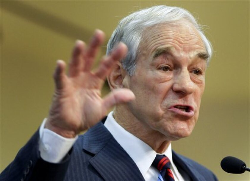 FILE - This Feb. 1, 2012 file photo shows then-Republican presidential candidate, Rep. Ron Paul, R-Texas speaking in Las Vegas. Ron Paul is exiting the political stage but his legions of rabble-rousing followers insist they are only getting started. Libertarian-leaning loyalists of the two-time Republican presidential candidate have quietly taken over key-state GOP organizations, ensuring future fights with the GOP's establishment and laying the groundwork for a future presidential candidate. (AP Photo/Julie Jacobson, File)