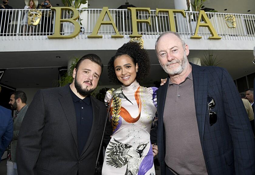 John Bradley, left, Nathalie Emmanuel and Liam Cunningham at the BAFTA Los Angeles + BBC America TV Tea Party.