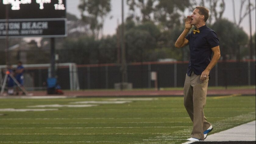 Fountain Valley's Head Coach Jimmy Nolan speaks to his players during a game against Troy in Hunting