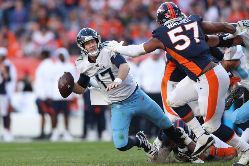 Tennessee Titans quarterback Ryan Tannehill is sacked by the Denver Broncos on Sunday.