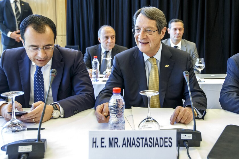 Greek Cypriot President Nicos Anastasiades, right, attends the Cyprus peace talks in Crans-Montana, Switzerland, Thursday, July 6, 2017.
