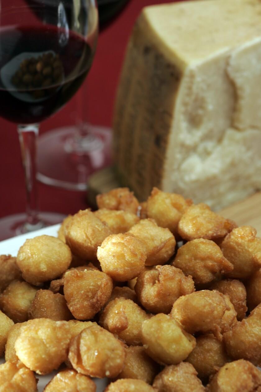 Osman, Stephen -- - Cheese Beignets, platter.