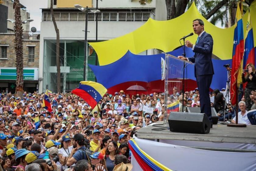"Venezuelan National Assembly Speaker Juan Guaido this Friday, April 19, 2019, calls on people at an ""open town-hall"" in Caracas to join in a grand march next May 1, Labor Day, to demand the armed forces' aid in ending the usurpation, as he calls the Nicolas Maduro government. EFE-EPA/Rayner Peña"