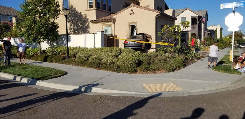 The car crashed into the home at the intersection of Lopelia Meadows Drive and Golden Lily Way.