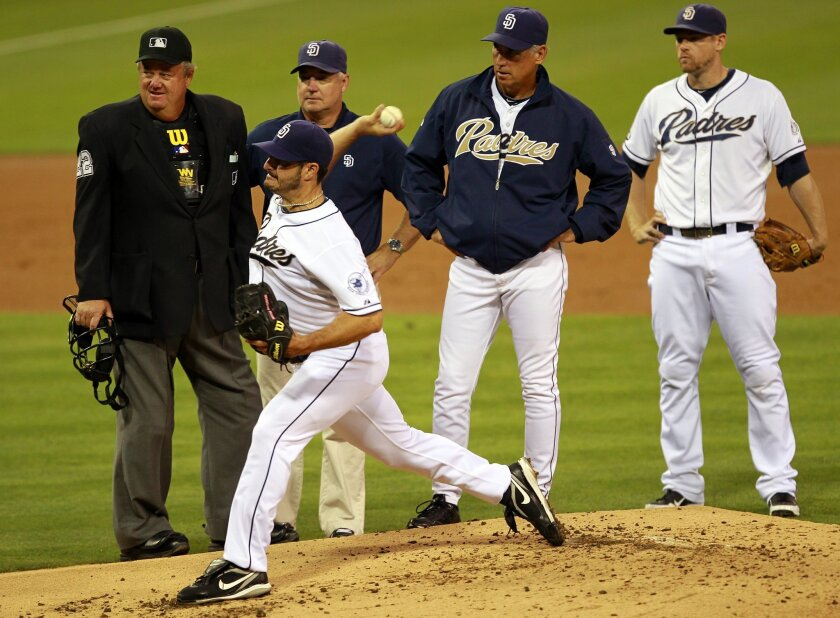 Padres Jason Marquis does some test pitches after he was hit on the hand by a line drive last August, the second straight time such a defensive play endedMarquis' season prematurely.