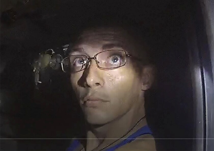 In this image, released by the Georgia Bureau of Investigation, taken from a deputy's body camera, Texas fugitive Dalton Potter is questioned during a traffic stop on Monday, Sept. 7, 2020, in Dalton, Ga. A GBI statement released Tuesday, Sept. 8, said one of two Texas fugitives wanted after a Georgia deputy was shot during the traffic stop, Jonathan Hosmer, has been apprehended, while Potter remains at large. (Georgia Bureau of Investigation via AP)