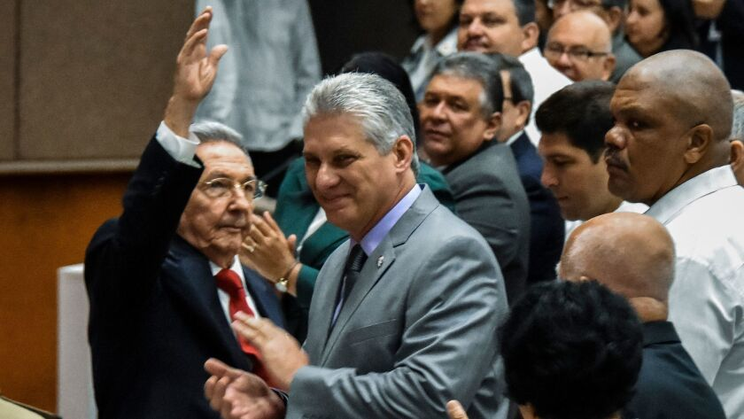 Cuban President Raul Castro, left, with First Vice President Miguel Diaz-Canel, center, during a National Assembly session in Havana on April 18, 2018, that will select the Council of State ahead of the naming of a new president.