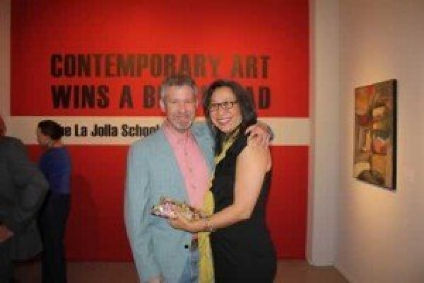 "Curator Dave Hampton with his ""secret weapon,"" Gayle Kauihou, at the opening of the La Jolla School of Arts show at OMA. Danielle Susalla Deery"