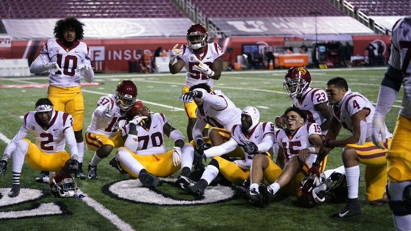 USC players pose for a photo after their game against Utah on Nov. 22, 2020, in Salt Lake City.