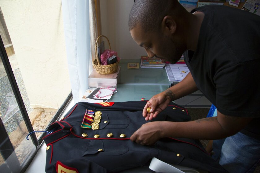 Anthony Jolimeau who has PTSD after his deployment to Iraq still holds his time in the Marines very close and wishes he was still serving.  He keeps his Marines dress blues close by and near ready condition for inspection.