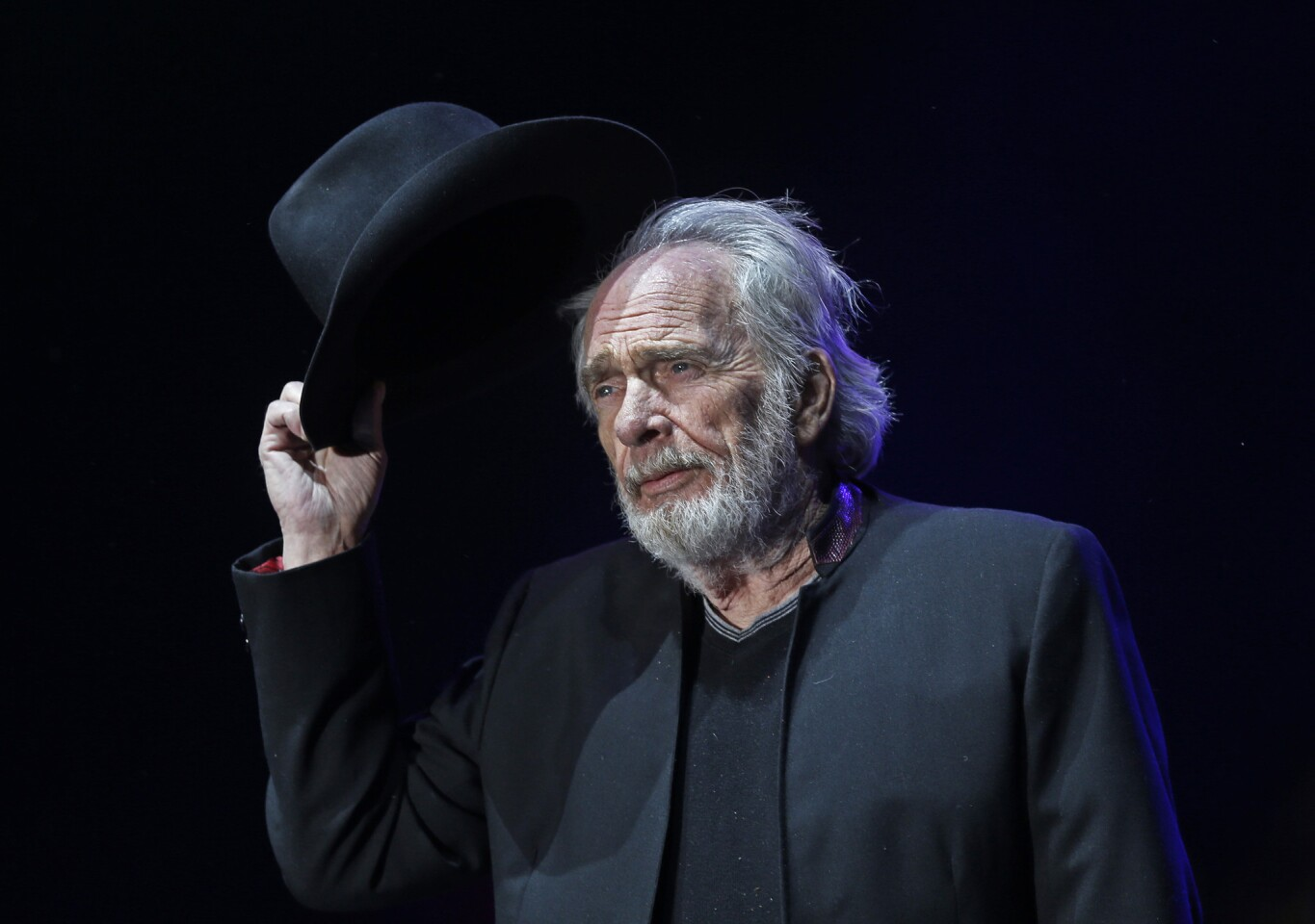 Merle Haggard tips his hat to the crowd as he performs at the Stagecoach Country Music Festival in Indio on April 24, 2015.