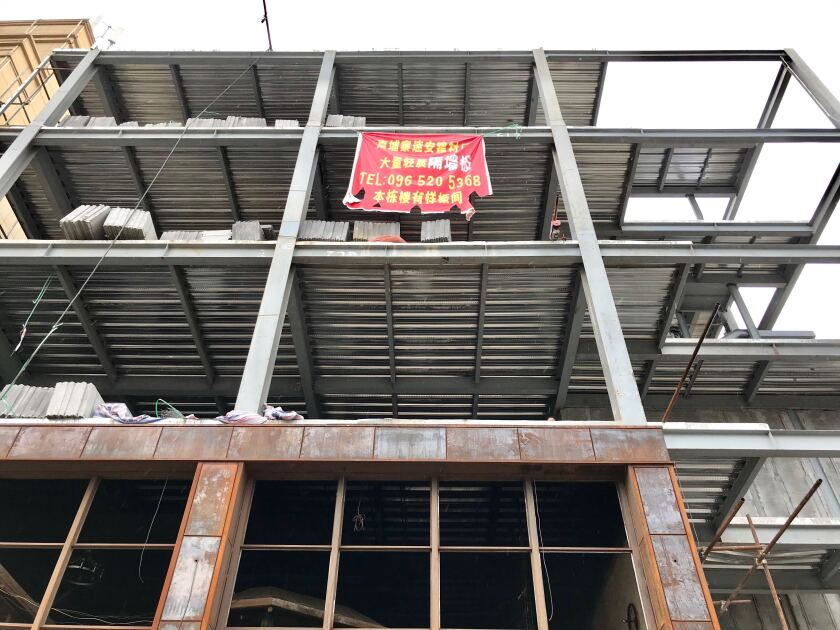 A Chinese sign hangs off a construction site in Sihanoukville, Cambodia.