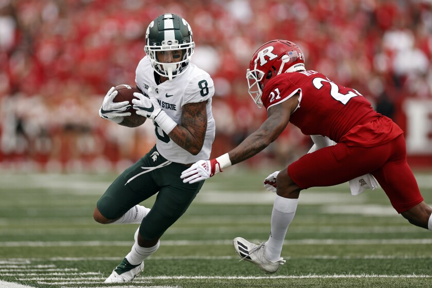 Michigan State wide receiver Jalen Nailor (8) is forced out of bounds by Rutgers defensive back Tre Avery during the first half of an NCAA college football game Saturday, Oct. 9, 2021, in Piscataway, N.J. (AP Photo/Adam Hunger)