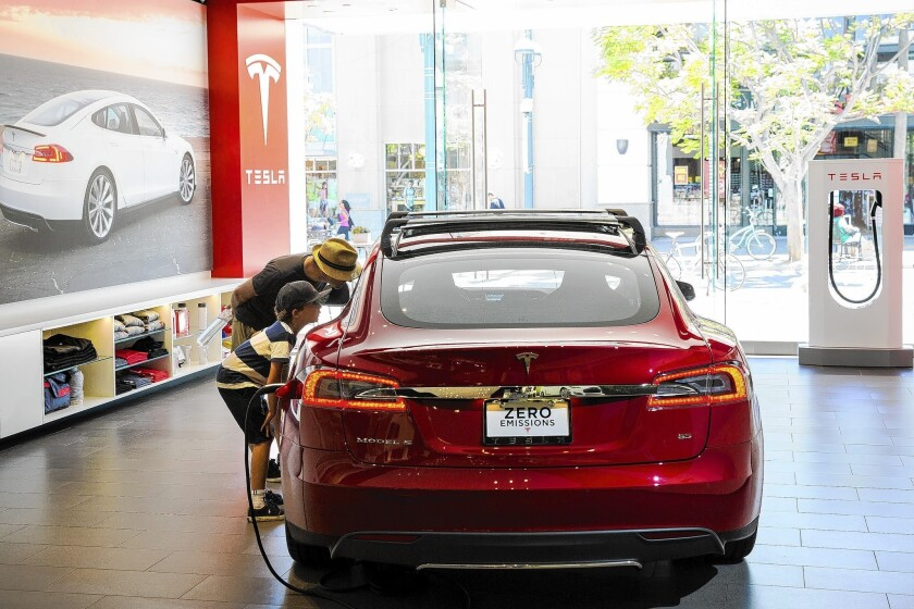California rebates have encouraged many car shoppers to buy Tesla's premium electric Model S, which starts at about $71,000, a Tesla executive says. Above, Tesla's Santa Monica showroom.