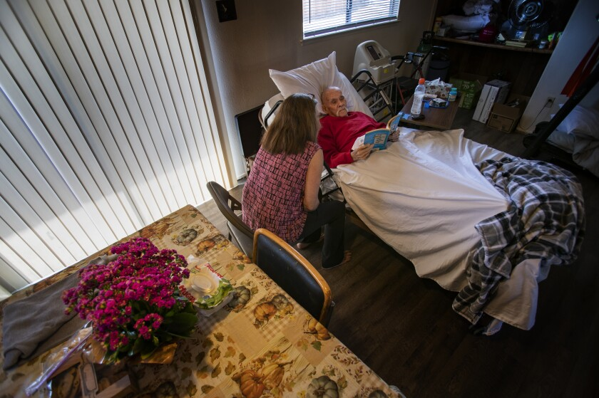 Debbie Erwig sits with her husband Bernie, 84, at their home.