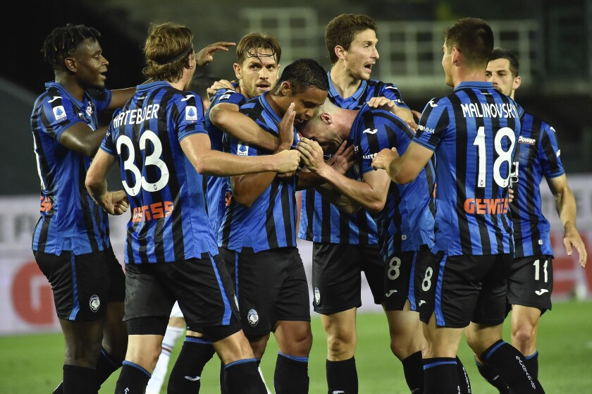Atalanta's Luis Muriel celebrates with teammates after scoring during the Serie A soccer match between Atalanta and Sampdoria at the Gewiss Stadium in Bergamo, Italy, Wednesday, July 8, 2020. (Gianluca Checchi/LaPresse via AP)