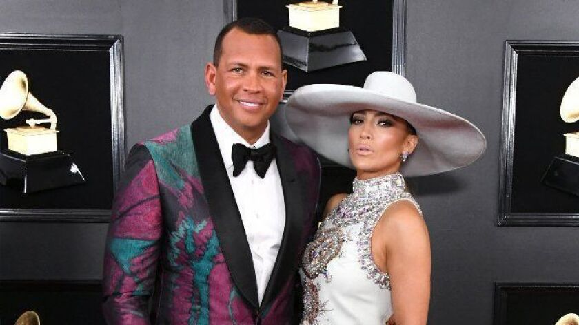 Alex Rodriguez has sold his home in the Hollywood Hills for $4.4 million. Above: At the Grammys in February with partner Jennifer Lopez.