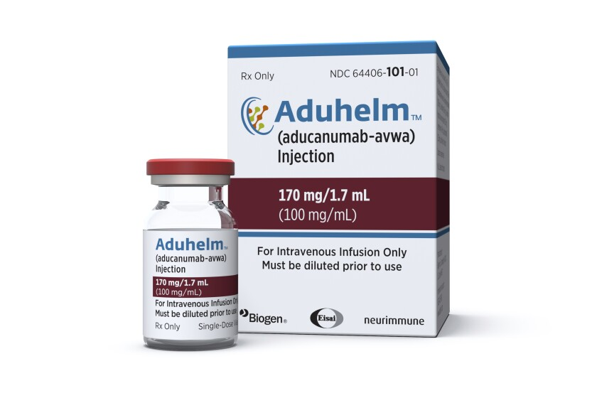 This image provided by Biogen on Monday, June 7, 2021 shows a vial and packaging for the drug Aduhelm. (Biogen via AP)