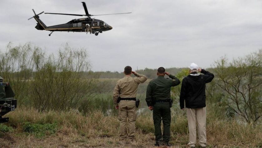 President Trump salutes a U.S. Customs and Border Protection helicopter in McAllen, Texas, on Thursday.