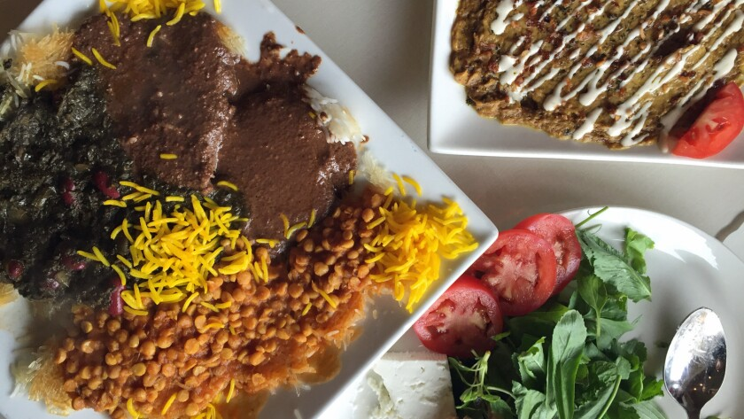 On the left, a plate of tahdig topped with three kinds of stew at Darya in West Los Angeles.