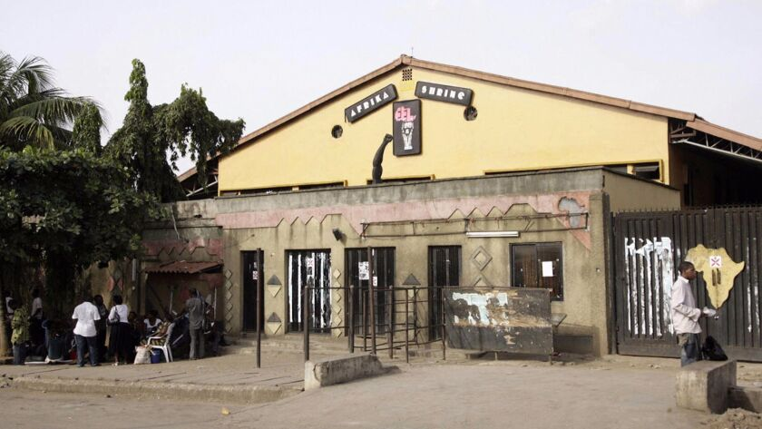 People hang out outside the new Africa Shrine, a music venue built and owned by Femi Kuti, a son of the Afro-beat legend Fela Kuti, on May 28, 2009, in Lagos, Nigerla.
