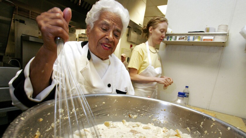 Leah Chase mixes her bread pudding at Muriel's restaurant in New Orleans on April 12, 2006.
