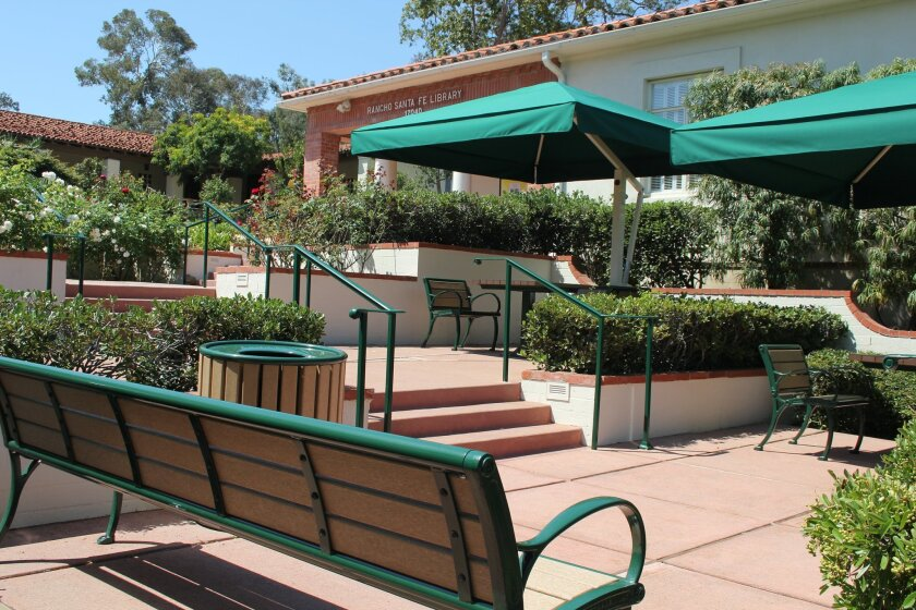 The Rancho Santa Fe Library's new patio features new benches, tables and umbrellas. Photo by Karen Billing