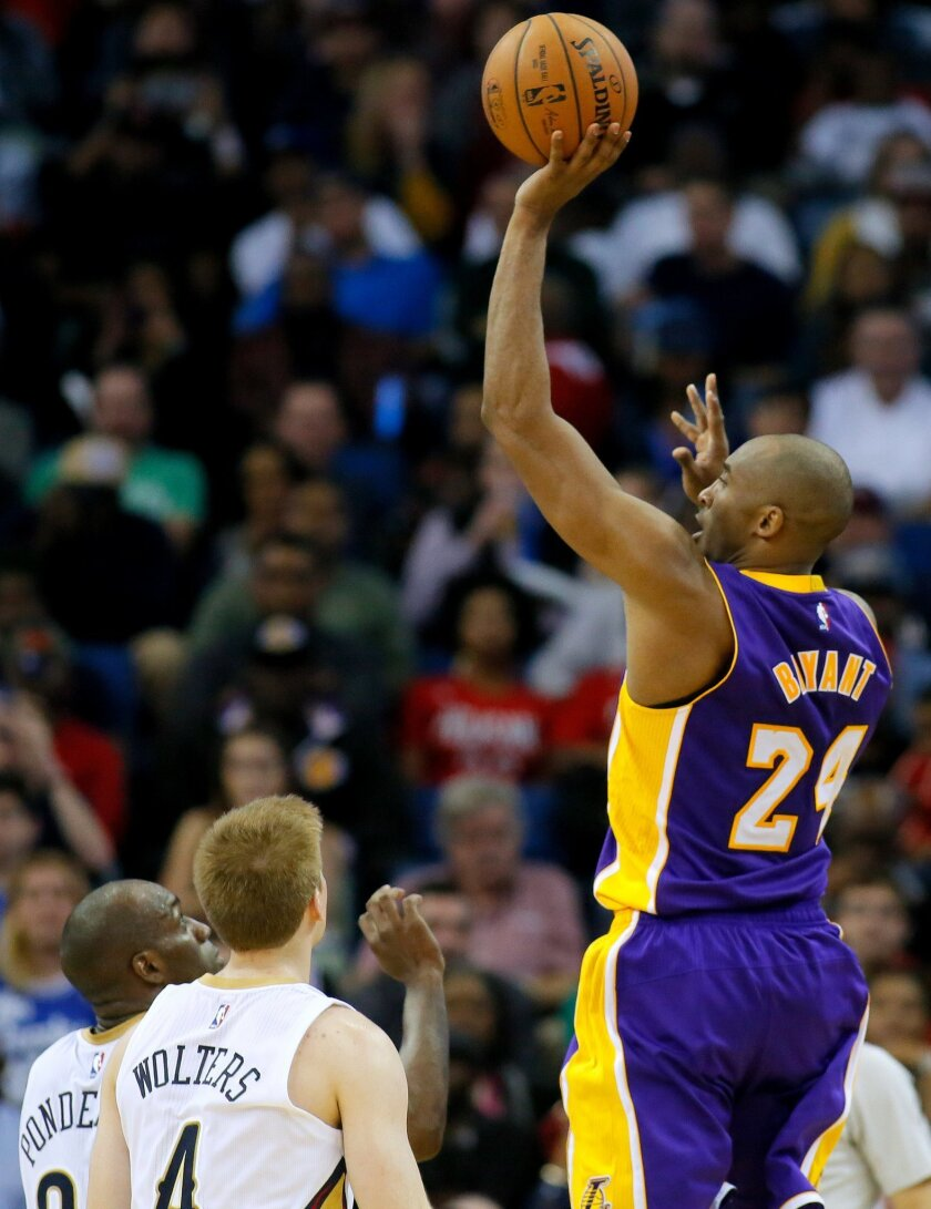 In this Wednesday, Jan. 21, 2015, photo, Los Angeles Lakers guard Kobe Bryant uses his left hand as he makes a shot during the second half of an NBA basketball game against the New Orleans Pelicans in New Orleans. Bryant tore his right rotator cuff in the Lakers' latest defeat, the club announced T