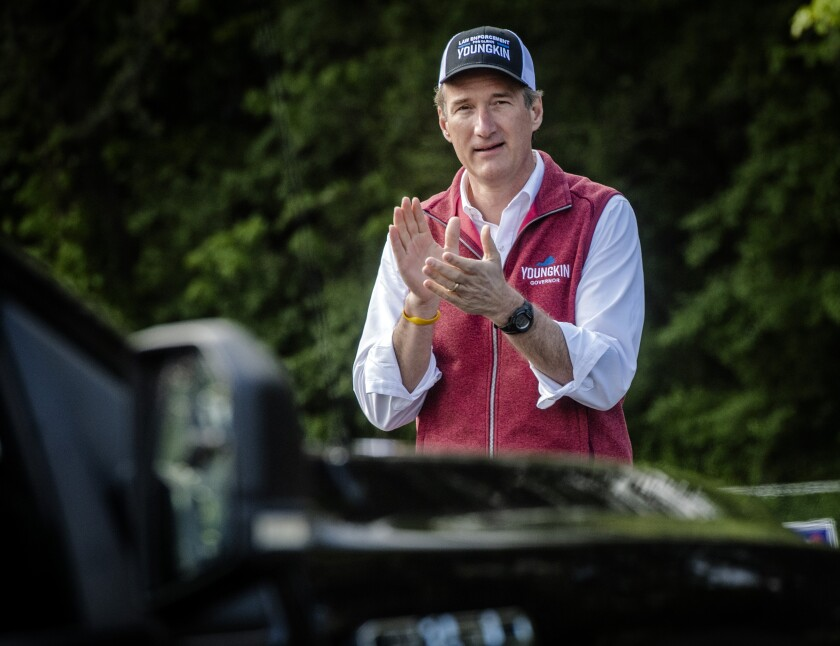 Gubernatorial candidate Glenn Youngkin works the line of cars as the Virginia GOP holds a drive-thru primary to select candidates for the 2021 general election, Saturday, May 8, 2021, in Annandale, Va. (Bill O'Leary/The Washington Post via AP)