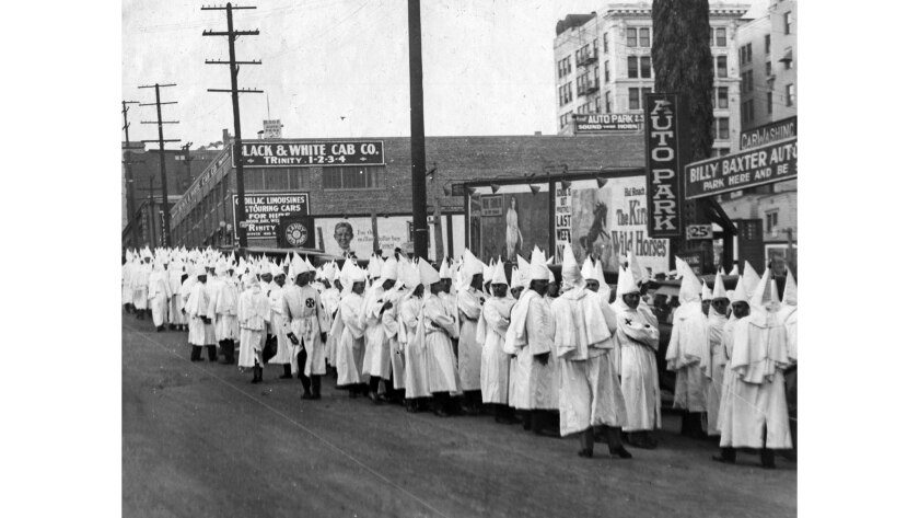 June 29, 1924: Members of the Ku Klux Klan gather at 5th and Olive streets in downtown Los Angeles f